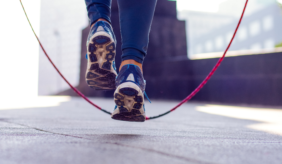 Athlete using a skipping rope, representing the importance of being agile in cloud development