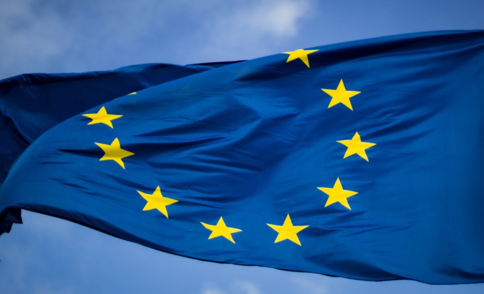 The European Union flag blowing in a breeze.