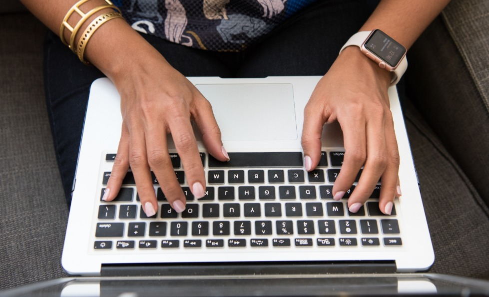 A woman working on a keyboard